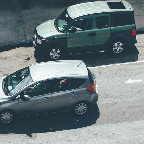 aerial view of cars driving on a city street
