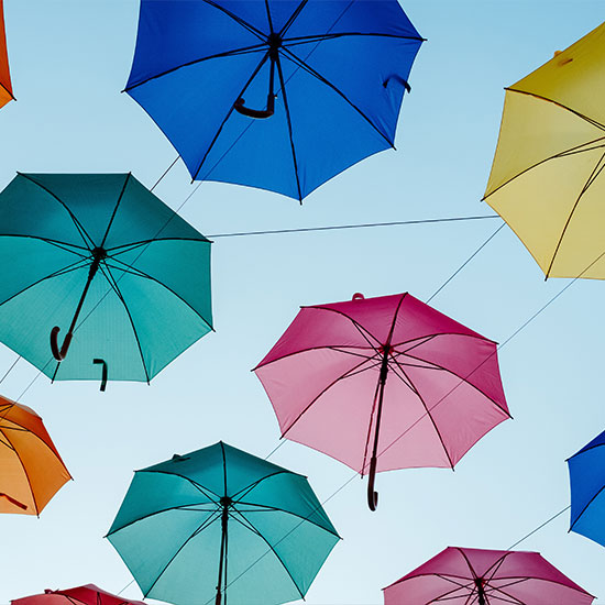 colorful umbrellas strewn across the sky