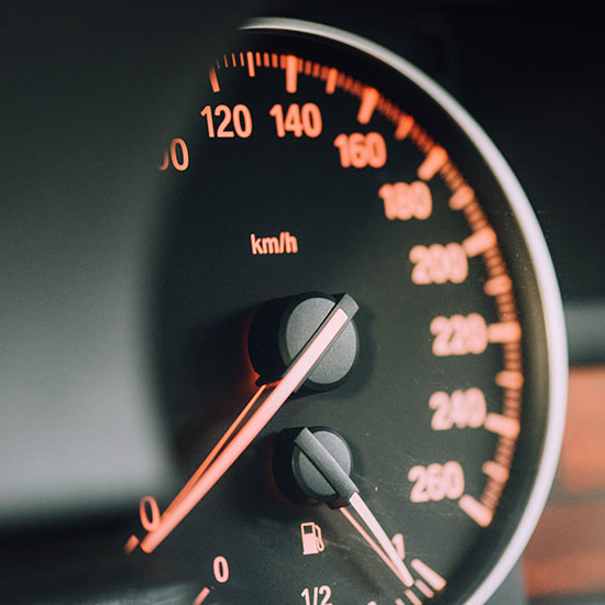close up of a speedometer on a car's dashboard