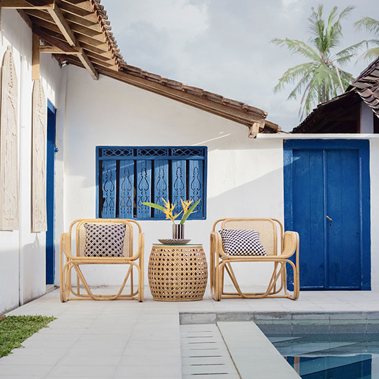 outdoor patio chairs and table, next to a private pool