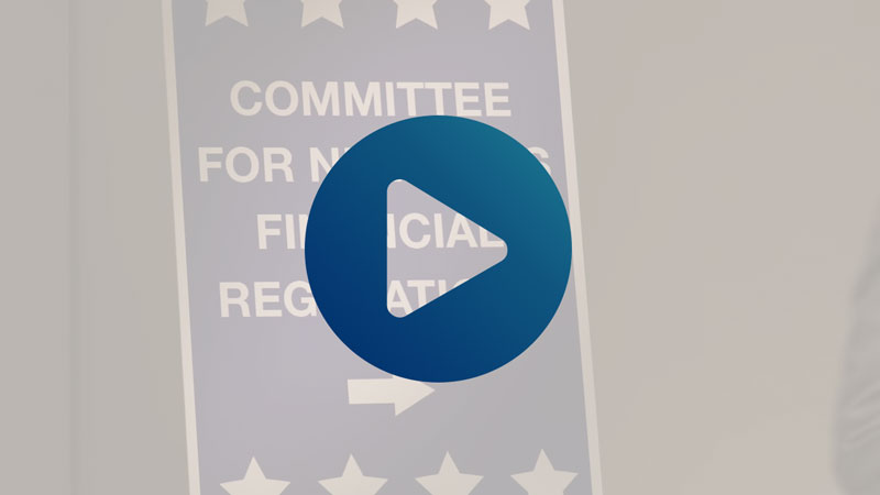 screengrab from CUNA video with play icon overlay; political signage