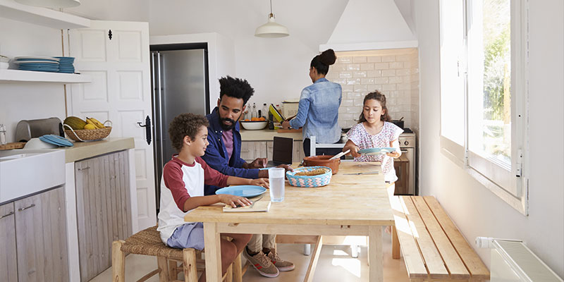 happy family eating together in their kitchen